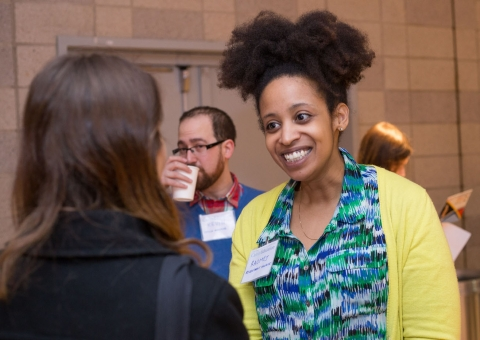 Employer smiling at student in conversation at career fair