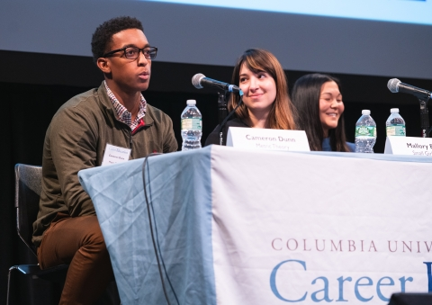 Panelists speaking to students