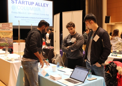 Employers from Sailthru in front of Startup Alley Sign