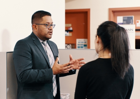 Employer speaking with a student in the CCE lounge