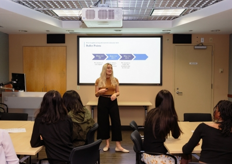 Student delivering presentation in CCE conference room