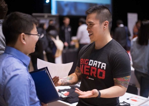 Recruiter talking to a student at the Startup Career Fair.