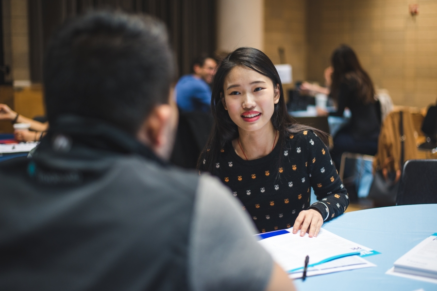 Student talking with an employer.