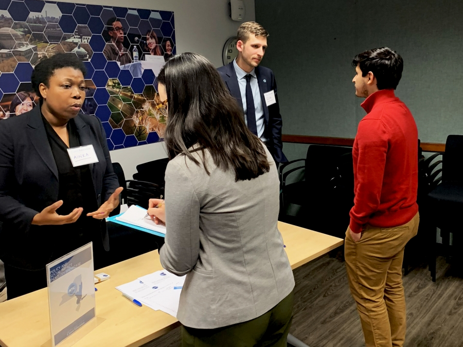 Students and employers talking at the Policy and Social Impact Showcase.